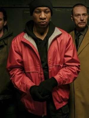Captive State Jonathan Majors Red Jacket